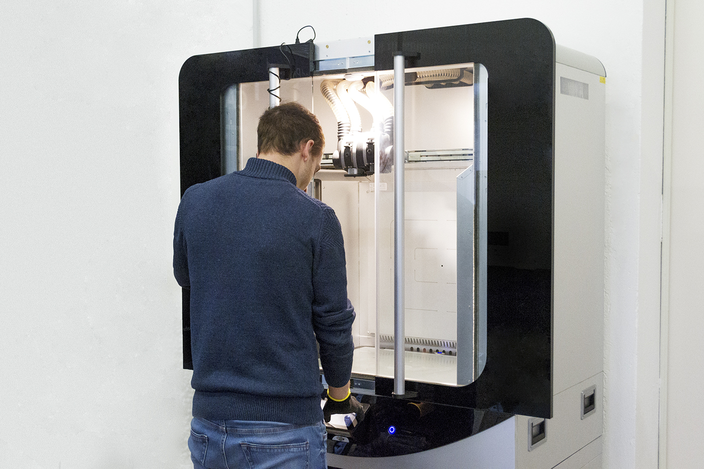 Man using FDM technology for production